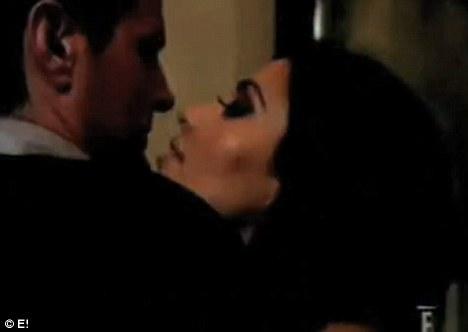 kim kardashian kisses shango!